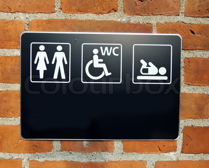 Stock image of 'Toilette sign on wall'