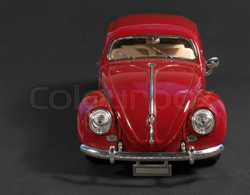 Editorial image of 'Red model car in dark back'