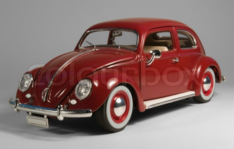 Editorial image of 'Red model car in grey back'