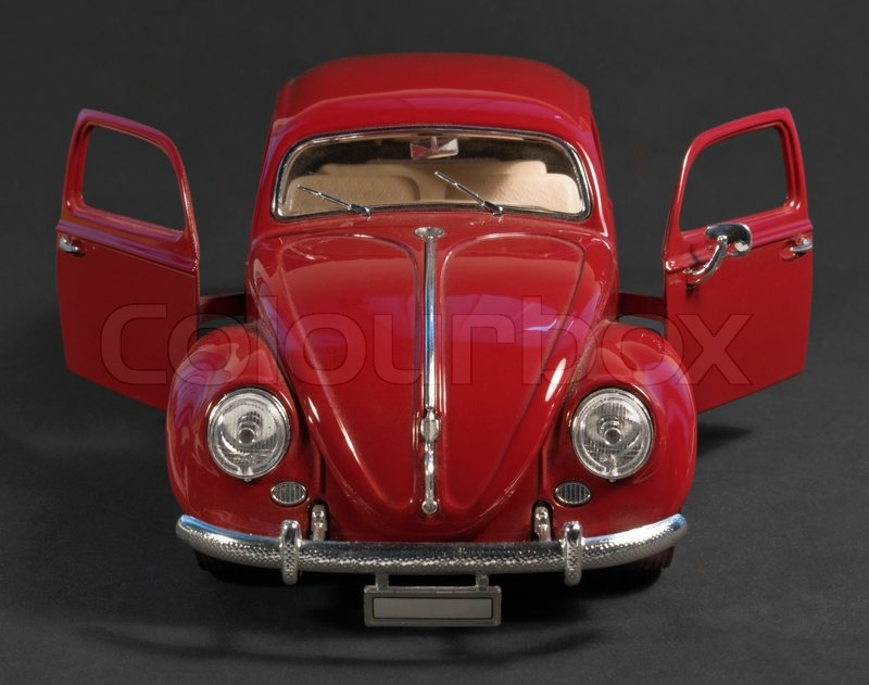 Editorial image of 'Red model car front with open doors'