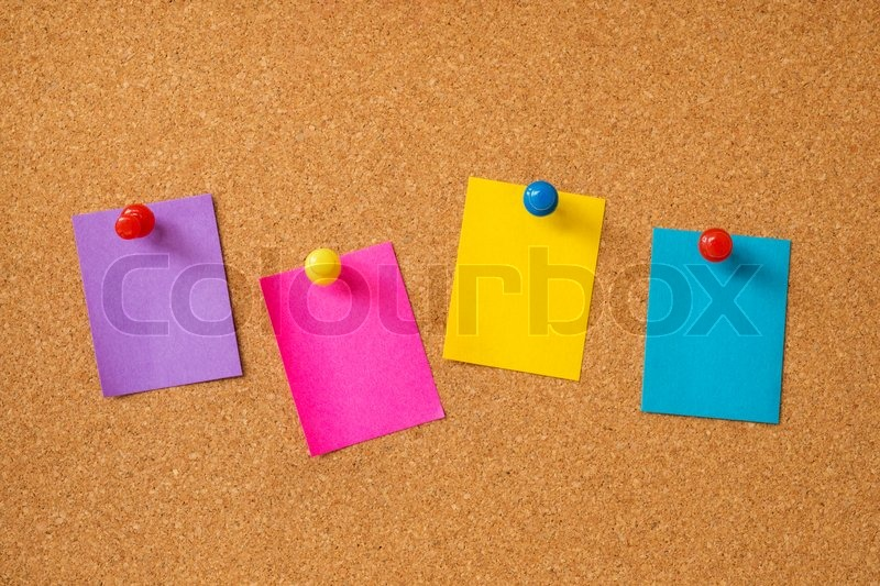Stock image of 'Colorful sticky notes on cork board'