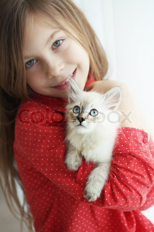 Stock image of 'Child and kitten'