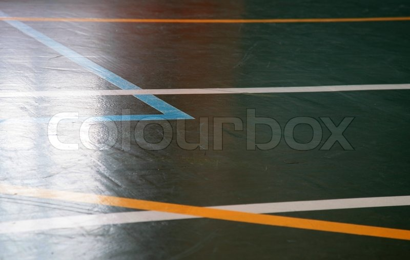 Sport hall shining floor texture with marking lines, stock photo
