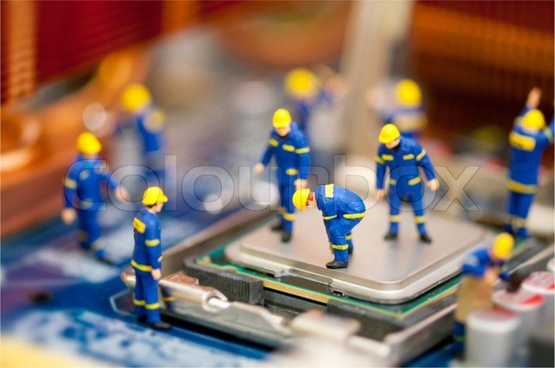 Miniature Technician Repairing Computer Stock Photo