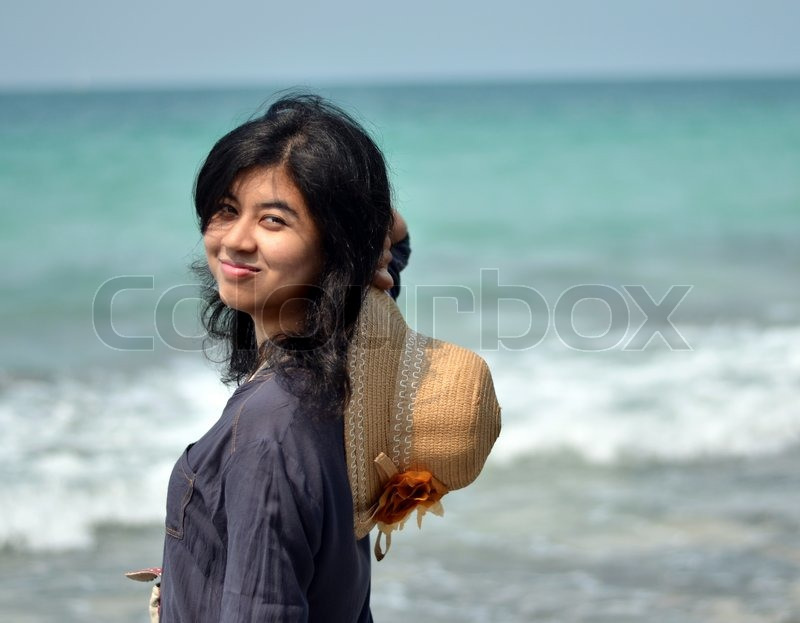 Stock image of 'Portrait of asian woman on beach'