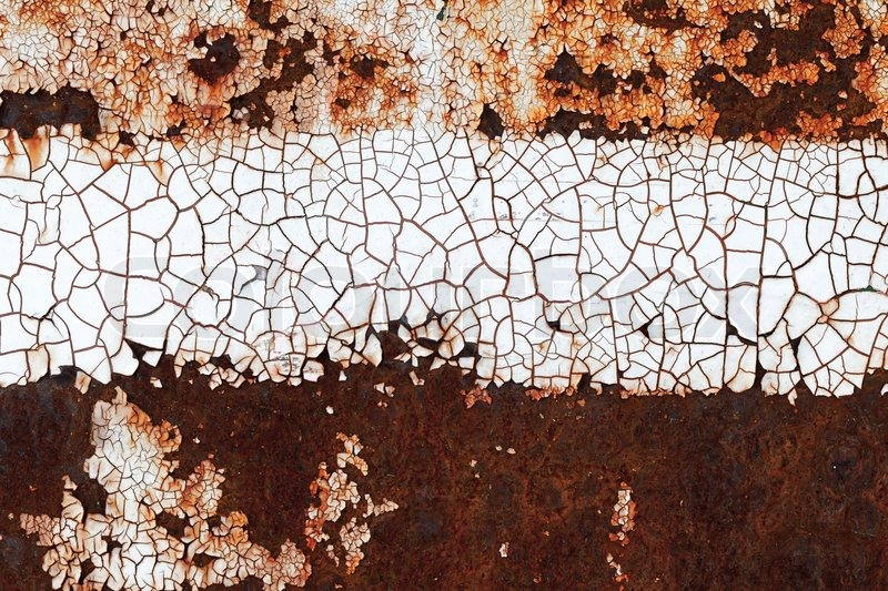 Old rusted metal wall texture with abstract pattern on cracked white