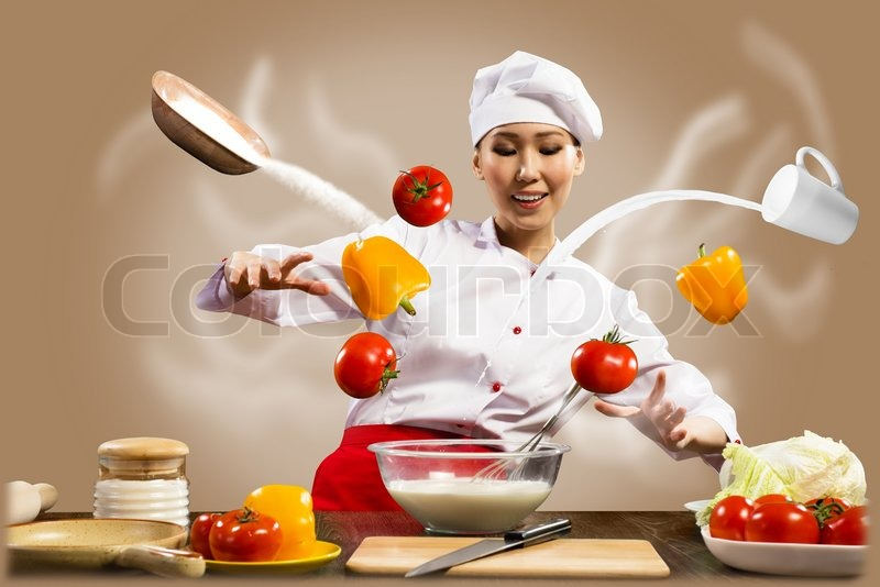 Asian female chef in the kitchen conjures stock photo for Chef comes to your house