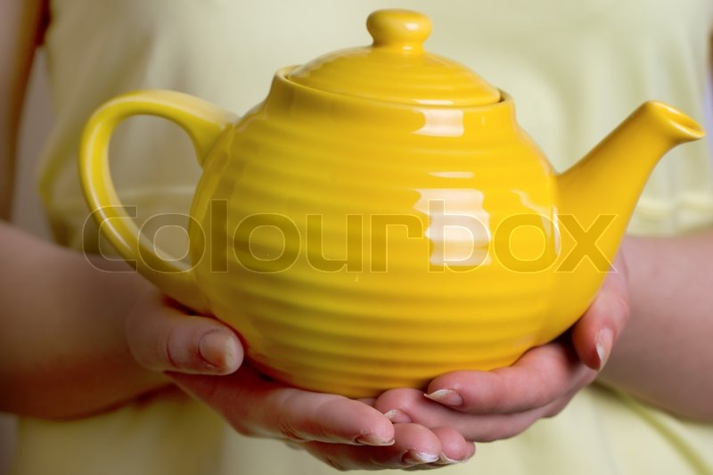 Women S Hands Holding Yellow Teapot Stock Photo Colourbox