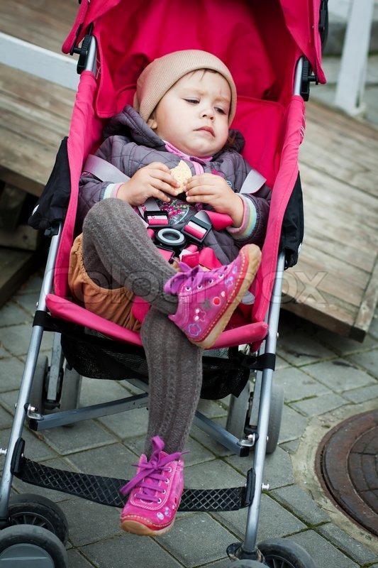 Baby in stroller Stock Photo Colourbox