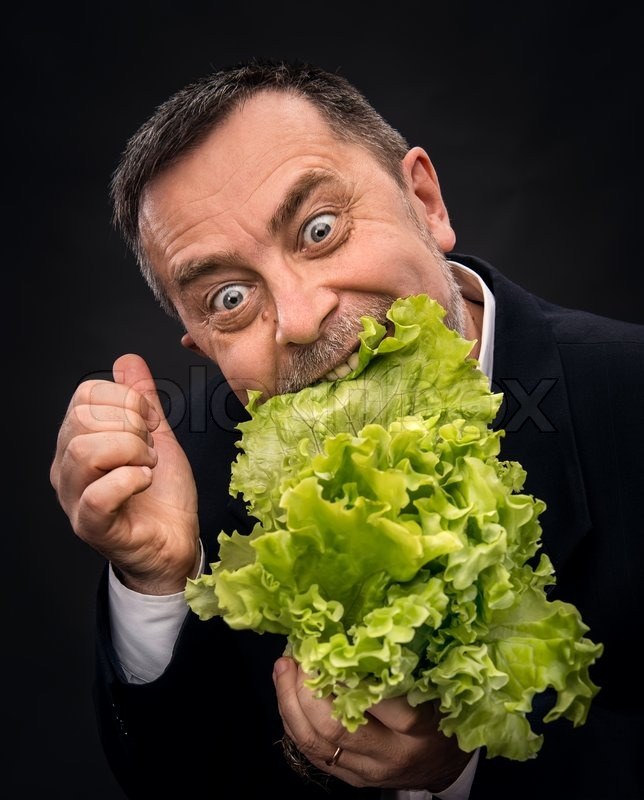 General Store Stock Photos General Store Stock Images: Man Holding And Eating Lettuce