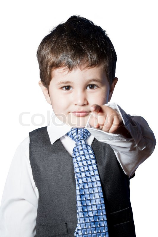 a small boy in the studio dressed up in a suit and pretending to be