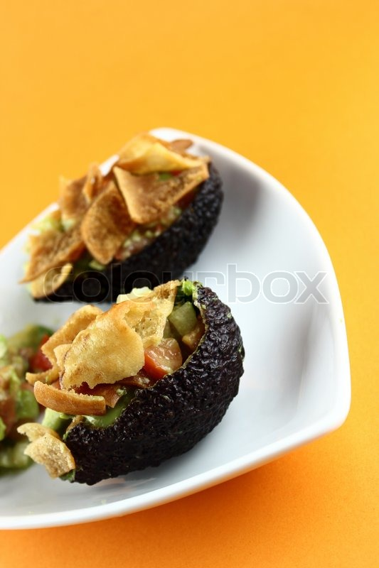 Stock image of 'Healthy Avocado Salad stuffed with Crispy bread, tomato and salsa'