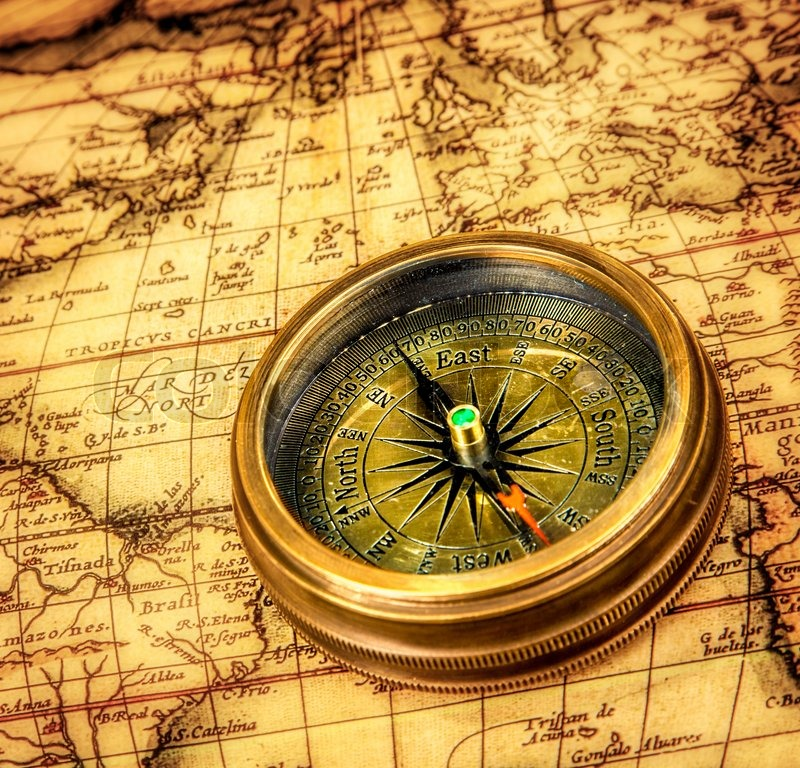 Vintage compass lies on an ancient world map stock photo colourbox stock image of vintage compass lies on an ancient world map gumiabroncs Image collections
