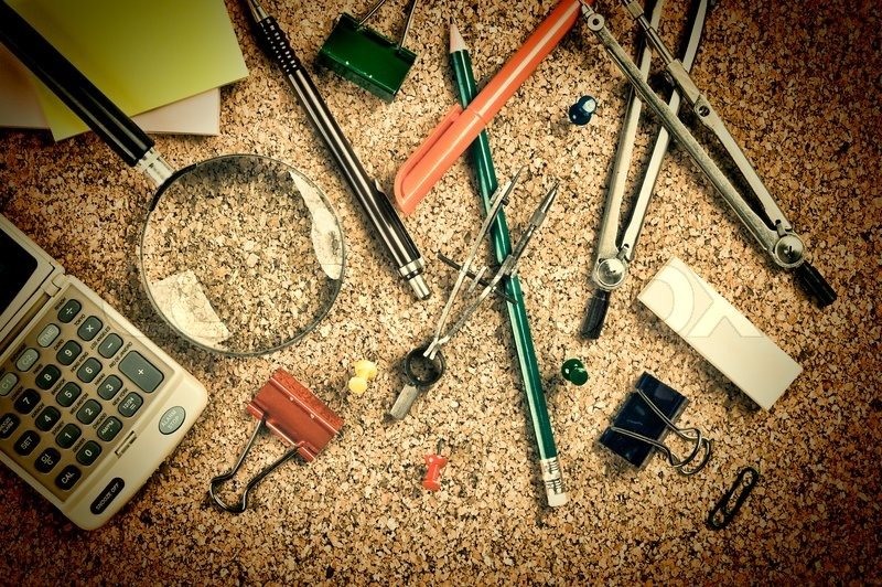 Office supplies in a mess on the table, stock photo