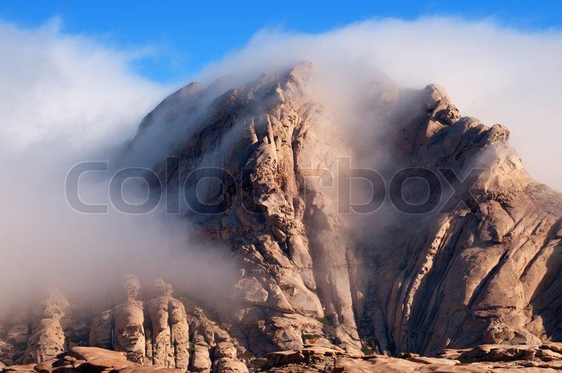 Clouds in desert mountains Bektau-Ata in Kazakhstan, stock photo