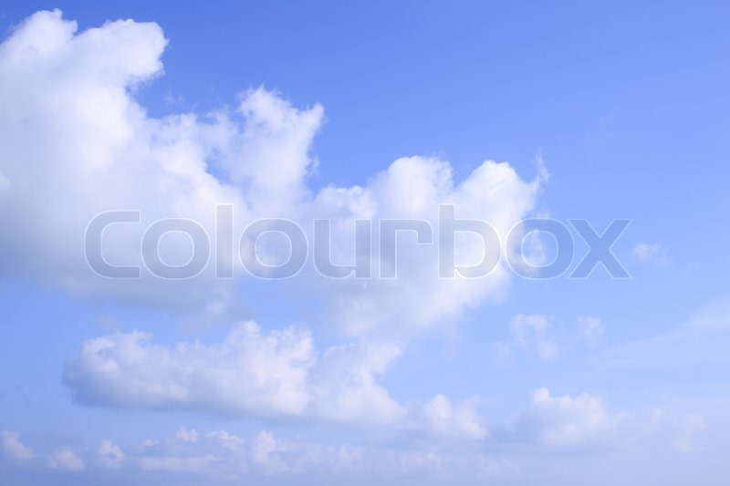 Heart clouds and blue sky background, stock photo