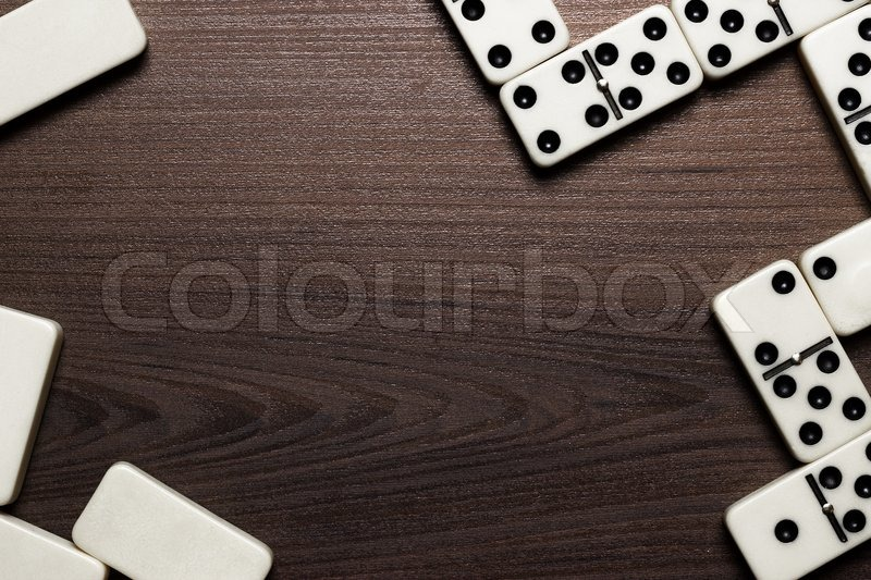 Domino Pieces Over Wooden Table Background Stock Photo