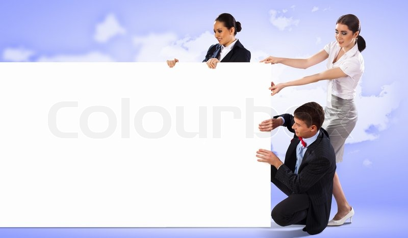Image of three young people holding blank banner against purple background. Place for text, stock photo