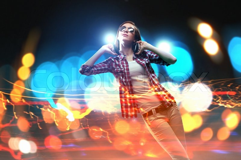 Stock image of 'Young girl listens to music'