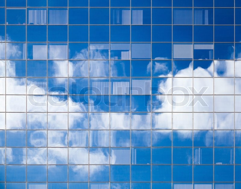 abstract background texture with bright clouds reflected in windows of modern office building stock photo abstract 3d office building