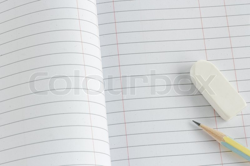 Close up of pencil and eraser on paper page, stock photo