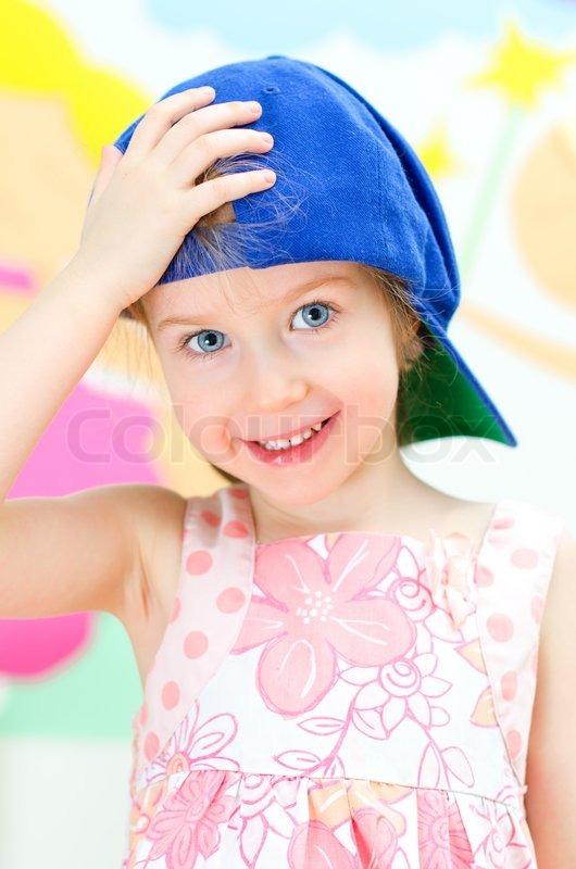 Cute little girl in a baseball cap  f92137c1048