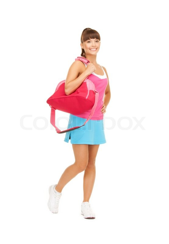 Sporty woman with sports bag | Stock Photo | Colourbox