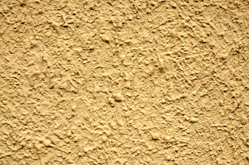 A yellow stucco wall useful for     | Stock image | Colourbox