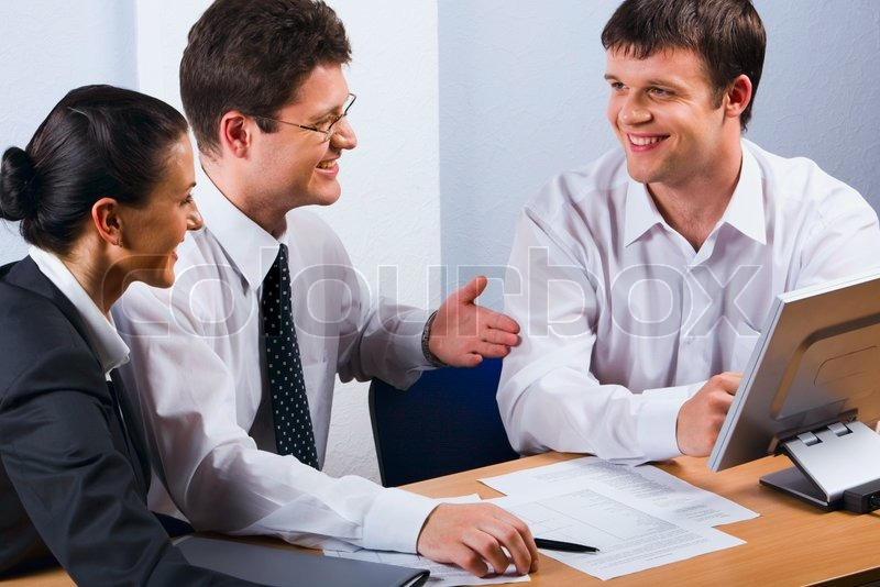 Business people talking at the workplace, stock photo