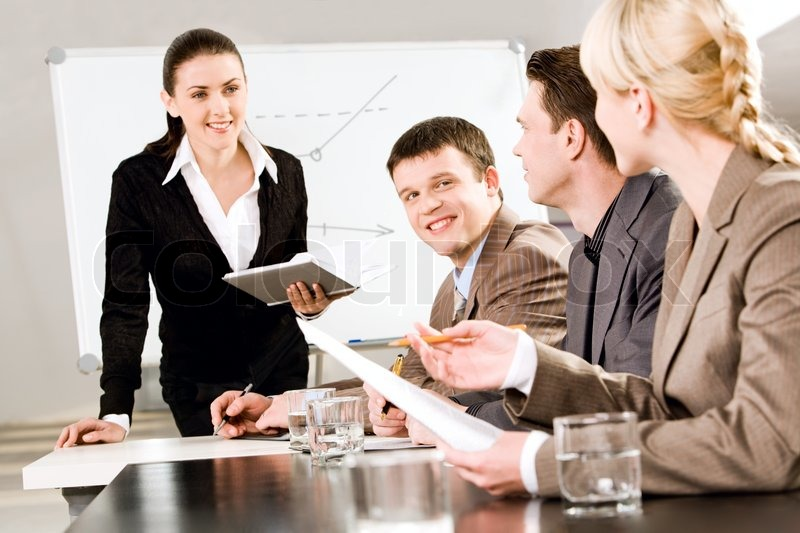 Portrait of business people discussing a new strategy at a seminar , stock photo
