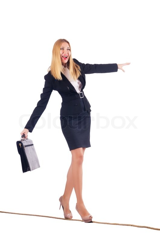 Businesswoman Walking On Tight Rope Isolated Stock Photo