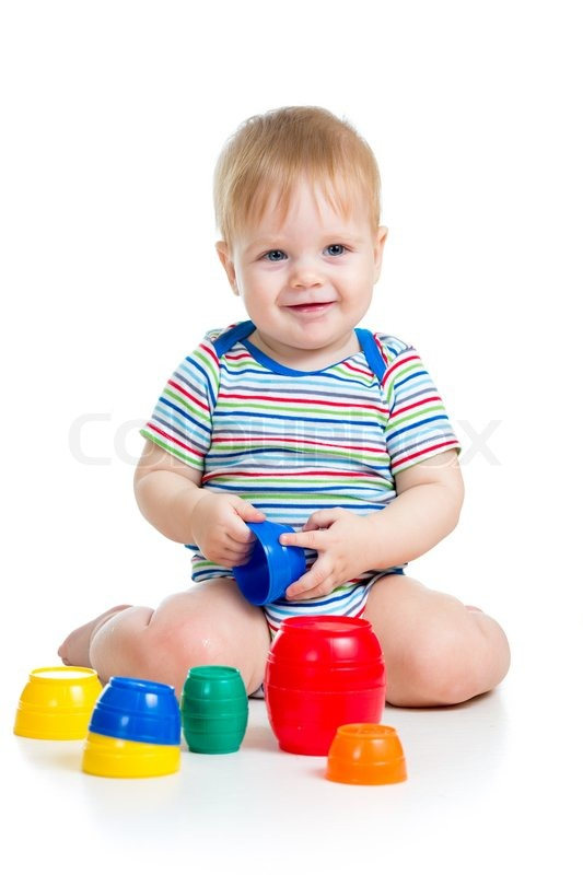 Baby Floor Toys : Cute baby boy playing with toys while sitting on floor