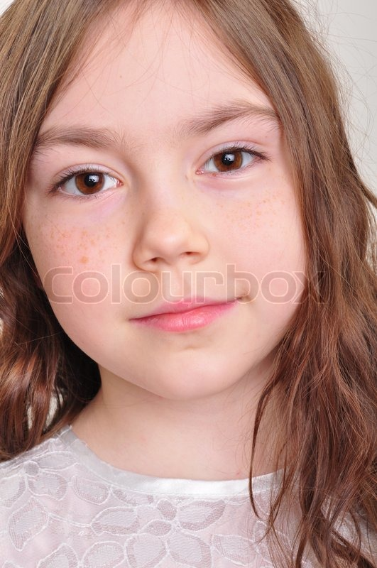 Pretty 8 Year Old Girl In White Dress Stock Photo