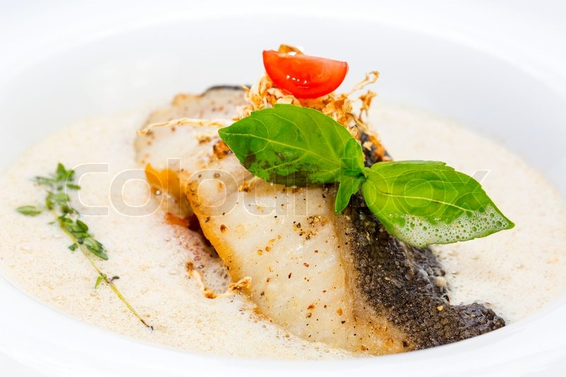Roasted fillet of grilled fish in a white sauce stock for White sauce for fish