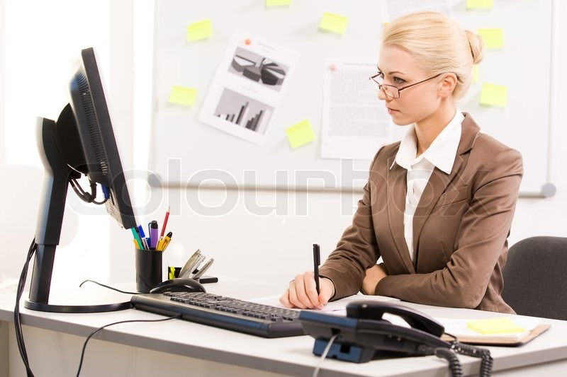 Lady Sitting at Computer of Executive Lady Sitting