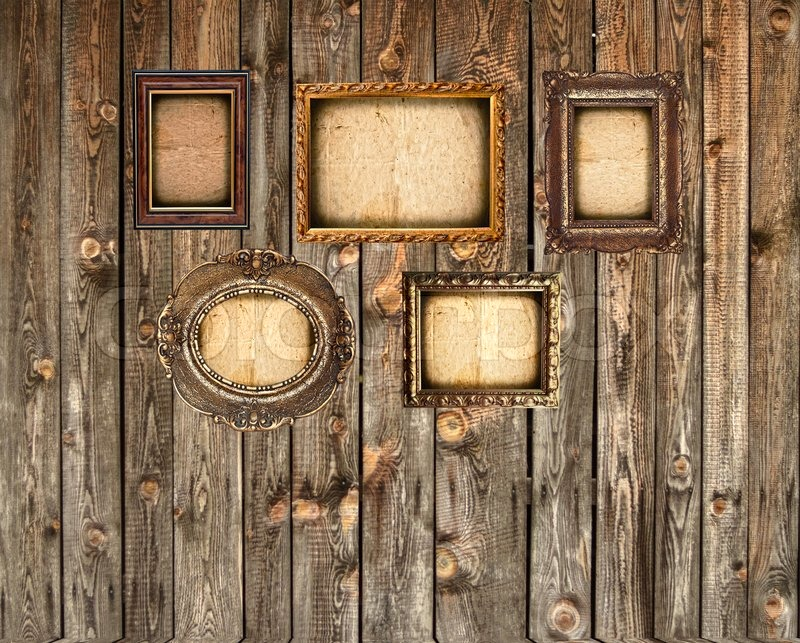 Set of empty picture frames on wooden wall | Stock Photo | Colourbox