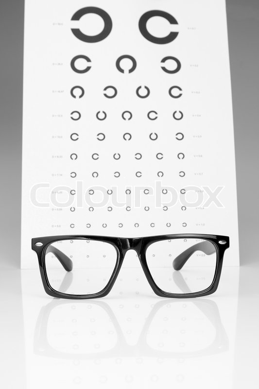 Table Golovin And Glasses Eye Examination. On A Gray Background. | Stock  Photo | Colourbox