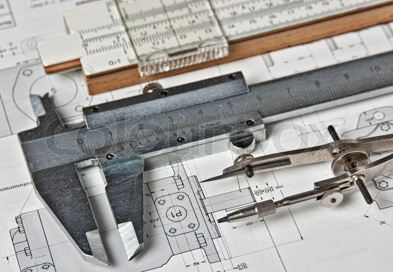 Old engineering tools on a technical drawing, stock photo
