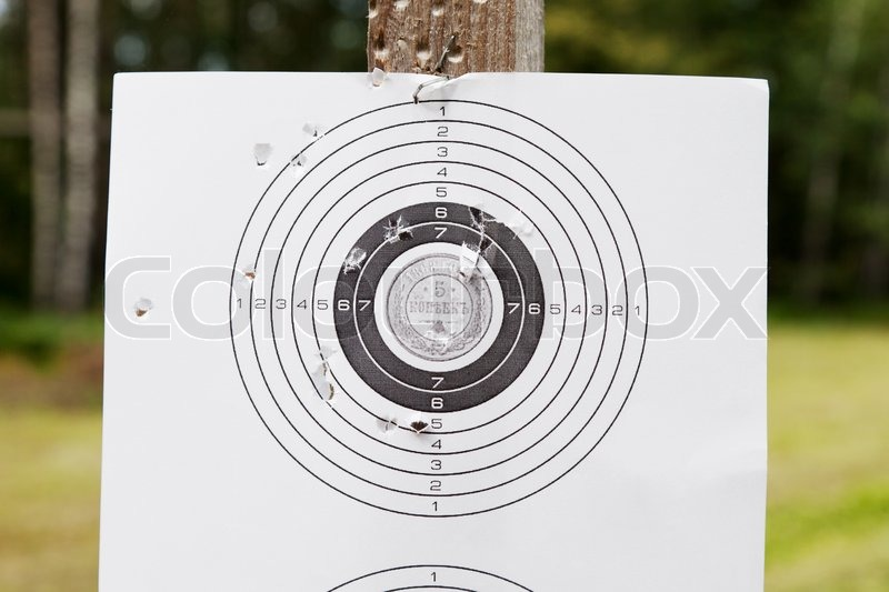 Shooting practice target with bullet holes, stock photo