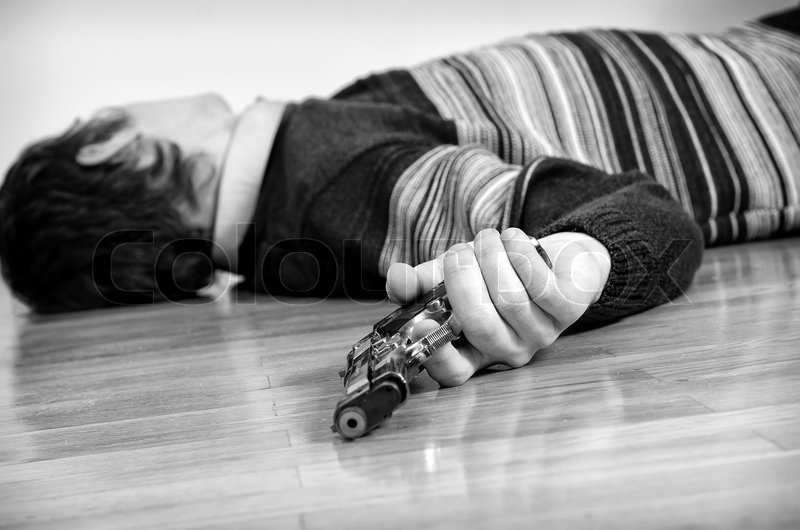 Man with gun laying on the floor. Black