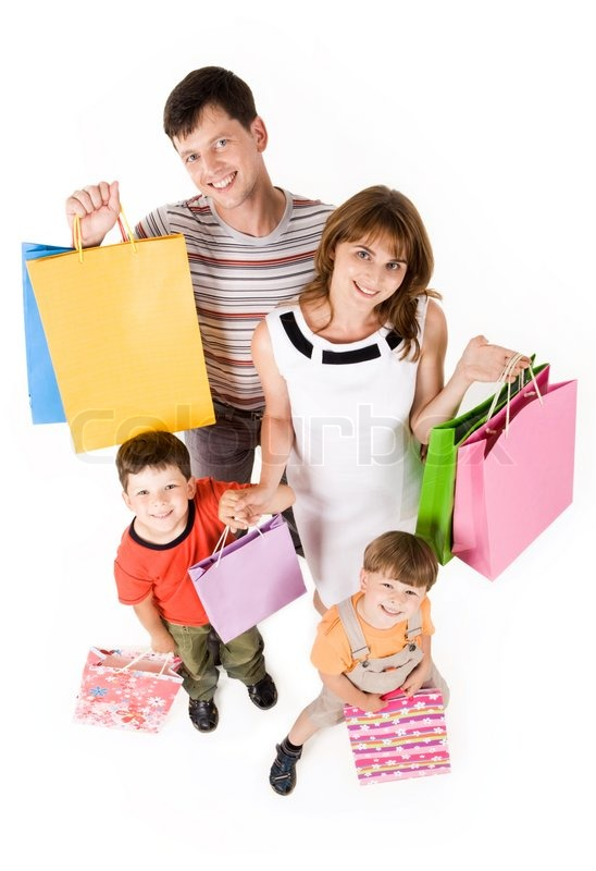 Family shopping in mall carrying bags | Stock Photo | Colourbox