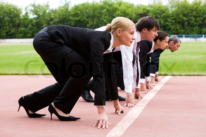 Row of business people getting ready for race, stock photo