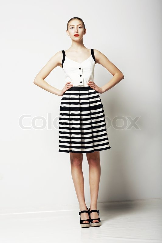 Trendy Kvinde i Stripped nederdel og | Stock foto | Colourbox