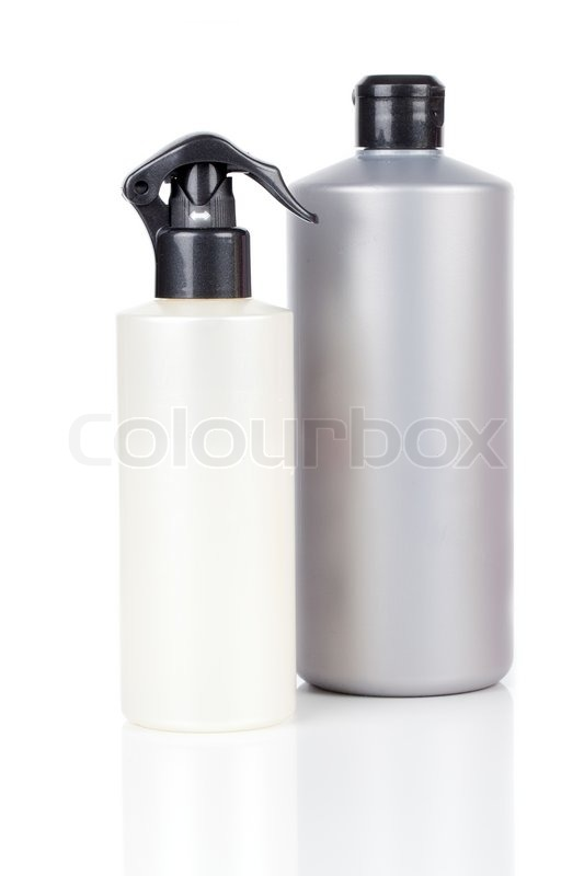 Two Plastic Bottles Of Hair Care Products With Soap Or
