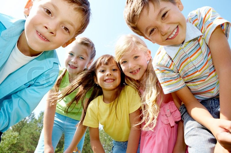Stock image of 'Portrait of happy kids outdoor looking at camera'