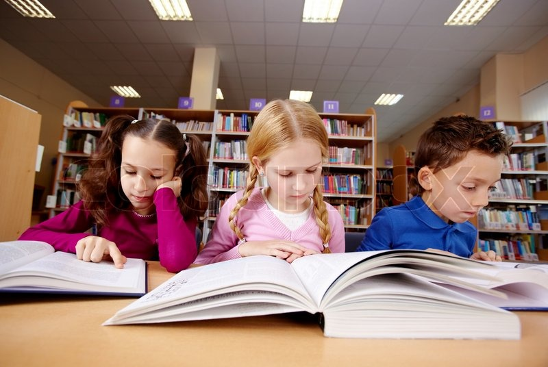 Stock image of 'Portrait of pupils looking at pages of textbooks at reading lesson '