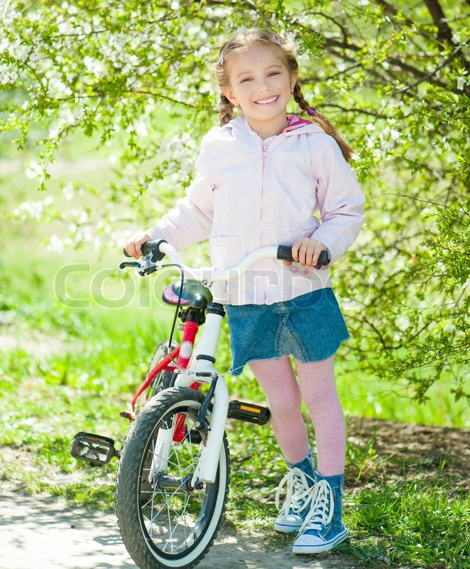 Little Girl On Her Bike Stock Photo Colourbox