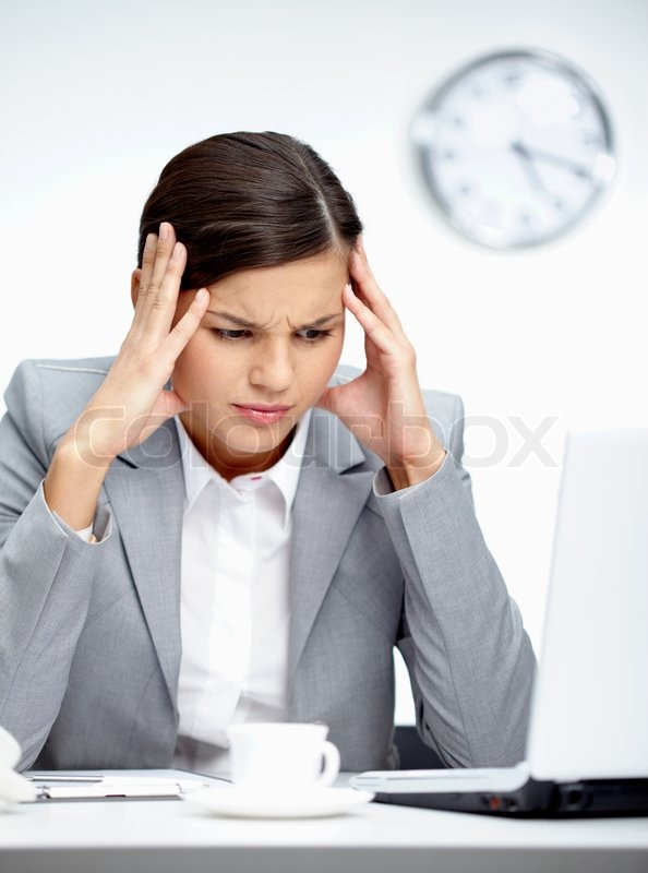 Image of young employer looking at laptop with troubled expression, stock photo