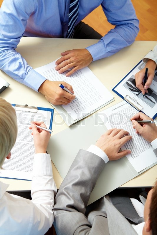 Image of business people hands working with papers at meeting, stock photo