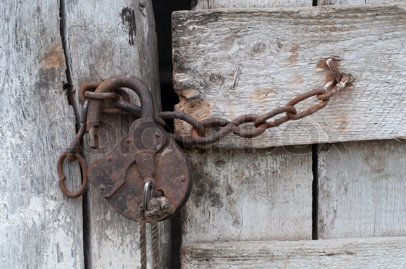 Lock With A Chain On An Old Wooden Door Stock Photo